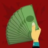 Hand som rymmer pappers- pengar Royaltyfri Fotografi