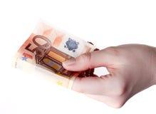 Hand som rymmer räkningen för euro som 50 betalar begrepp Royaltyfri Foto