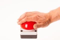 Hand som skjuter en röd summer royaltyfri bild