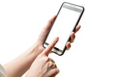 Hand som spelar smartphonen på isolerat Arkivbild
