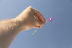 Hand som sträcks som en religiös gest Arkivbild