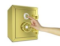 Hand som trycker på guldkassaskåpet Arkivbild