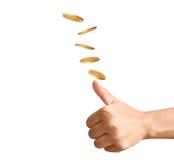 Hand som upp kastar myntet för att göra beslut Fotografering för Bildbyråer