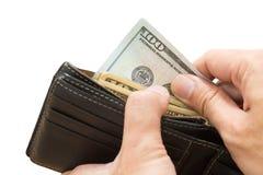 Hand som väljer plånboken för dollarräkning som isoleras Royaltyfria Foton