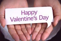 Hand som visar lycklig dag för valentin` s Royaltyfria Foton