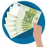 Hand som visar pengar Arkivfoto