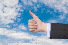 hand som visar upp tumen Royaltyfri Foto