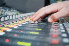 Hand on the sound desk Stock Photo