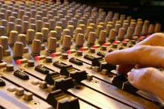 Hand and sound mixer. A hand with sound mixer pannel detail view Stock Image
