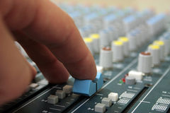 Hand on sound mixer Stock Photos