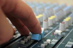 Hand on sound mixer Stock Photos