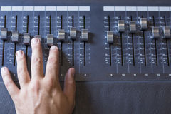 Hand and sound mixing desk Royalty Free Stock Image