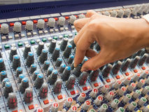 Hand of the sound producer. And mixer console Royalty Free Stock Images