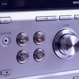 Hand on Sound volume control knob Royalty Free Stock Image