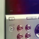 Hand on Sound volume control knob Stock Photo