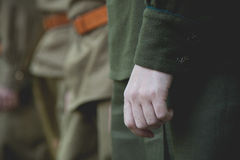 The hand of the Soviet officer. In greatcoat Royalty Free Stock Photo