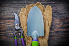 Hand spade secateurs safety gloves on wooden board agriculture c Stock Photography