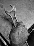 Hand with spanner Royalty Free Stock Images