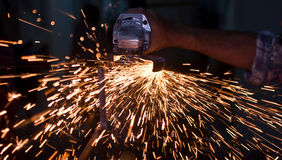 Hand and sparks. Men work in construction making sparks Stock Image