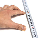 Hand specifying the distance on tape-measure Royalty Free Stock Image