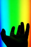Hand in the spectrum Stock Photos