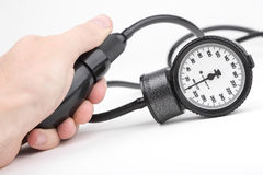 Hand and sphygmomanometer for blood pressure Stock Images