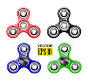 Hand spinner. Fashionable toy. Stress reduction. Fine motor skills. Rotating flywheel. A set of colorful objects. Royalty Free Stock Photography