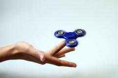 Hand spinner, fidgeting hand toy. Blue Hand spinner, fidgeting hand toy royalty free stock photography