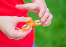 Hand with spinner toy Royalty Free Stock Photos