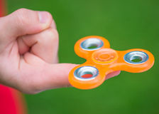 Hand with spinner toy Stock Photography