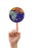 Hand and spinning globe Royalty Free Stock Images