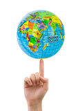 Hand and spinning globe Royalty Free Stock Photos