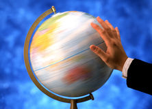 Hand spinning globe. A hand shipping the globe very fast Stock Image