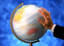 Hand spinning globe Stock Image