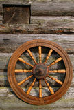 Hand Spinning Wheel. On the wall of the old log house in the Russian village Stock Photography