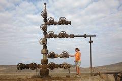 Hand spinning wheel on oil pipeline in Azerbaijan desert Stock Images