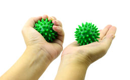 Hand with Spiny plastic green massage ball isolate on white Royalty Free Stock Photos