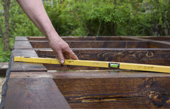 Hand With A Spirit Level Ruler Stock Photo