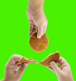 Hand split stroop wafle Royalty Free Stock Images