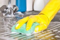Hand with sponge Stock Photos