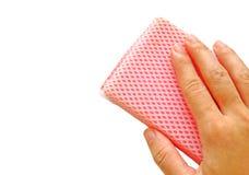 Hand with sponge. Isolated on white background Stock Photo