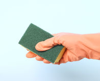 Hand with sponge. Cleaning with a sponge and glove Royalty Free Stock Image