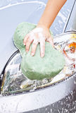 Hand with sponge Royalty Free Stock Images