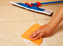 Hand with sponge clean a floor. Hand with sponge clean a house floor Royalty Free Stock Photography