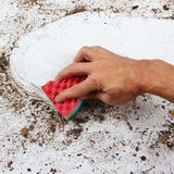 Hand with sponge cleans very dirty surface Royalty Free Stock Image