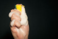 Hand with sponge Stock Image