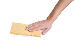 Hand and sponge rag. Female hand with a yellow sponge rag Stock Image