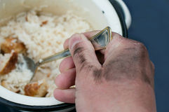 Hand With A Spoon Stock Photos