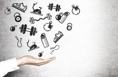 Hand and sporting goods Royalty Free Stock Images