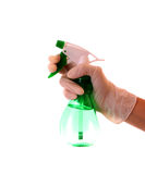 Hand with spray bottle Stock Photo